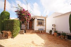 This traditional, four bedroom, three bathroom villa has its accommodation on three levels, situated in an elevated location with fine views across the valley to the sea.