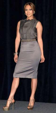 Jennifer Lopez WHAT SHE WORE Lopez wore her sleek sleeveless gray blouse and pencil skirt with T-strap metallic Sergio Rossi heels and a jeweled belt. Jennifer Lopez, Belle Silhouette, Hot High Heels, Christina Aguilera, Celebs, Celebrities, Looks Style, Her Style, Dress To Impress