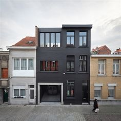 Matroyshka House by Buro Bill - This playful city house located in Antwerp, Belgium, consists of a new wooden home built inside the existing brick framework of the old house. It was designed in 2012 by Buro Bill.