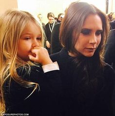 Victoria Beckham with Harper - At the Victoria Beckham Fall/Winter 2015 Fashion Show @ New York Fashion Week. (February 2015)