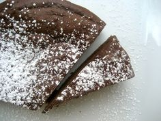Decadent Flourless Chocolate Cake Recipe Desserts with bittersweet chocolate, unsalted butter, large eggs, granulated sugar, salt, pure vanilla extract, heavy cream, confectioners sugar
