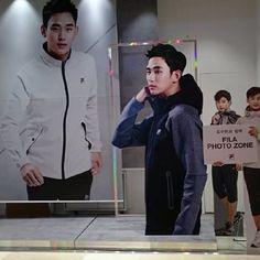 "cool Kim Soo Hyun In one of the shops ""FILA"""