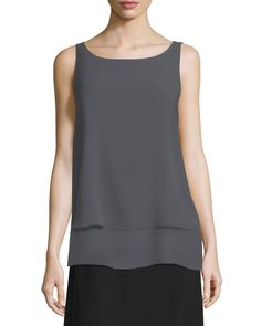 Eileen Fisher georgette crepe shell, available in your choice of color. Ballet neckline. Sleeveless; moderate shoulder coverage. Slim silhouette. Layered hem. Pullover style. Silk; machine wash. Impor