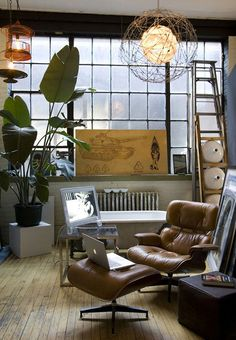 "30 Interiors Featuring The Iconic Eames Chair on Freshome. .....I say it's the ""Man Cave"" version. Is that the bathtub back there ...?"