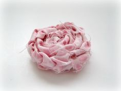 Braided rolled fabric flower. Could try with three different fabrics