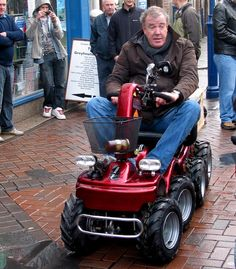 Jeremy Clarkson races his Top Gear co-presenters on a customized mobility scooter through Abergavenny. Why not?