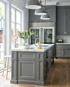 I like the gray with light quartz. The overall style is very appealing.    What if we moved kitchen toward dining area?