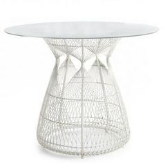 hagia dining table base by kenneth cobonpue