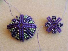 Bead Knitter Gallery:  Beaded bead or maybe a bead cap.  Schema is here: http://vyolina.skyrock.com/1793892982-schema-1-scaph-s.html   ~ Seed Bead Tutorials
