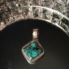 Turquoise Sterling Silver Mother of Pearl pendant From exclusive Sedona jewelry designer Starborn Creations, this exquisite turquoise pendant is made of solid sterling silver, lined with mother of pearl. Chain not included in this listing price. Southwestern, Native American, Boho, Hippie, Bohemian, Festival. Beautiful statement piece FREE PEOPLE TIFFANY CHANEL DAVID YURMAN BULGARI CARTIER Free People Jewelry Necklaces