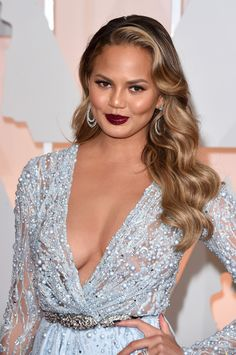 Go for some old-school Hollywood glamour and copy Chrissy Teigen's golden streaked curls. You'll look classic and alluring all at once.  - GoodHousekeeping.com