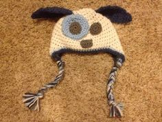 Free Crochet Pattern for Baby Puppy Hat, (brown puppy with pink spot and white eyes and nose)