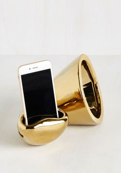A sleek gold speaker that amplifies your phone like a phonograph. | 25 Products You Need If You Love Your Phone
