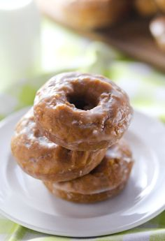 Glazed Pumpkin Donuts -- Baked in UNDER TEN MINUTES! Perfect Fall breakfast -- and saves me from running out to get donuts :)