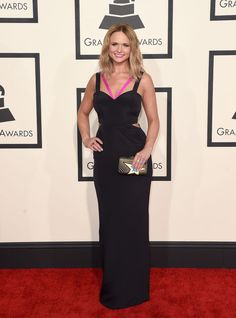 Gah, Miranda Lambert! My girl crush gets bigger all the time, and this just racheted it up another notch. This sexy black column dress would've been fantastic on its own, but the hot pink straps give it just a punch of personality that feels so Miranda.