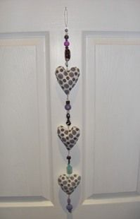 Handmade General Craft Item gift idea by Emma Seabrook found on MyOwnCreation: Decorative wall hanging of three hand made fabric hearts with a blue swirl design on a wire decorated with blue/ purple beads and a loop for hanging on the wall. It makes an interesting, quirky gift for a spouse, friend, mother or daughter you name it...