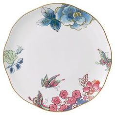 "Brimming with garden-chic appeal and timeless style, this beautiful fine bone china salad plate is perfect for your next Sunday brunch or ladies' luncheon.  Product: Salad plateConstruction Material: ChinaColor: White, gold, pink and blueDimensions: 1"" H x 8"" DiameterCleaning and Care: Dishwasher safe"