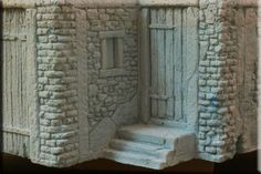Balsa-foam.   I like the look this has to it, kinda castle/ cottage looking!