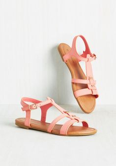 When your road trip takes you to a sunny locale, swap your sneaks for these pink sandals and treat the carpool to a cone! A fun vegan faux-leather pair to flaunt due to a T-strap silhouette, gold studs, and shiny buckles, these flats will inspire many more spontaneous escapades involving sweets.