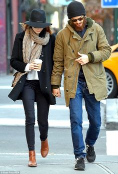 Smitten in the city: Meanwhile, Emma Stone, left, and her beau Andrew Garfield, right, were spotted on a romantic stroll in New York City on Monday