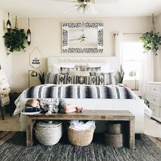A fantastic modern #boho bed.  Love the plants and the mirror as well as the baskets!