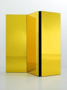 golden yellow mirrored room divider