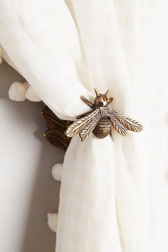 Anthropologie Queen Bee Tieback available in Bronze, Oxford, and Silver (Affiliate) || http://shopstyle.it/l/bAQk || Living room decor, living room ideas, Home decor, furniture, Home decor Ideas, Home decor Ideas living room, Home, Home ideas, Home design, Home design inspiration