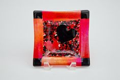 I can't get enough of these artists! This is a red and black iridescent fused glass frit heart, square bowl. It's perfect! by FusionIllusion at Etsy.