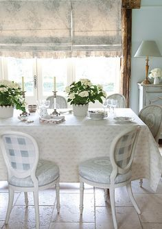 A beautiful dinning room with soft floral designs by Kate Foreman available at www.fabricsandpapers.com