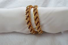Beautiful bangles with dark red and white stones