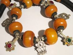Lovely faux amber and 11 silver hand made by tribalgallery on Etsy