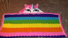 Crochet hooded unicorn blanket I made for my granddaughter. The pattern is by Briabby Designs and can be purchased here https://www.etsy.com/listing/555901423/crochet-pattern-hooded-unicorn-blanket?ga_order=most_relevant&ga_search_type=all&ga_view_type=gallery&ga_search_query=crochet%20hooded%20unicorn%20blanket&ref=sr_gallery_5 It is an excellently written, detailed, and easy to follow pattern! I'm sure I will make this one again!
