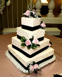 Subtle light pink wedding cake with black accents!