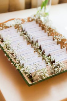 Love the nametags in babys breath. View the full wedding here: http://thedailywedding.com/2016/07/25/classically-elegant-wedding-paola-jason/