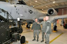 Chief Master Sgt. James Salway, 122nd Fighter Wing Command Chief, explains the loading process for 30mm rounds on the A-10 Warthog to Chief Master Sgt. Darrell Newman, Indiana Air National Guard Command Chief (left) and Chief Master Sgt. Christopher Muncy, Air National Guard Command Chief on February 11, 2012 in Fort Wayne, Ind. Muncy and Newman came to the base to visit with Airmen and participate in a town hall meeting. (U.S. Air Force photo by Staff Sgt. Justin Goeden)  Note: Pictured is…