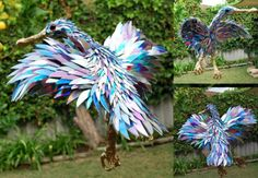 broken CDs bird sculpture by Sean Avery.  I want to hoard unused CD's now lol…