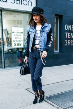 "Gigi's younger sister Bella was also spotted in the brand in early January. She paired the label's <a rel=""nofollow"" href=""https://miaouxx.com/collections/denim/products/brigitte-jean-pinstripe"">$325 pinstripe pants</a> with a graphic tee, a hoodie, and a denim vest. She also added the Miaou's $85 <a rel=""nofollow"" href=""https://miaouxx.com/collections/belts/products/chain-belt"">metal chain-link belt </a>and $325 <a rel=""nofollow""…"