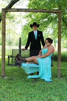 This is how we dress for Prom in Tennessee. Boots, check. Horseshoe necklace, check. My cowboy with me, check.