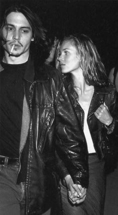 Kate Moss and Johnny Depp in matching leather jackets.