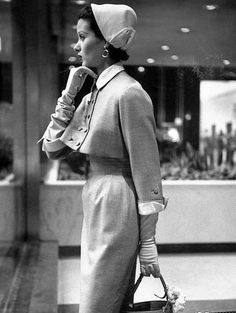 Model in short loose jacket over a fitted slim sheath by Harvey Berin, photo by Gordon Parks, 1953