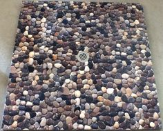 This River Rock Shower Base is actually smooth to the feet (and pleasing to the eyes!) Bathroom Plans, Downstairs Bathroom, Bathroom Ideas, River Rock Shower, Shower Base, Shower Floor, Rock Floor, Bamboo Room Divider, Bathroom Colors