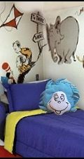 decorate a busy patterned bedroom with solid color bedding. Dr Suess bedroom murals.