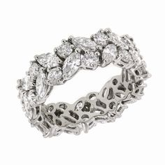 Platinum marquise and round-cut diamond wedding band. Only $28,500. I wish!