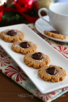 Peanut Butter Blossoms  - chocolate peanut butter thumbprints, grain-free and sugar-free for a healthy holiday treat