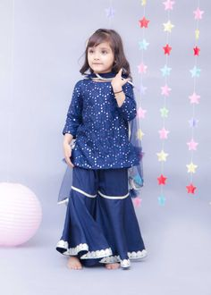 This Delightful Dark Blue Mirror Embroidered Sharara Set is an excellent choice for the next wedding function that your little girl has to attend. The Kurti of the set has a round neck and full sleeves. Baby Girl Dress Design, Girls Frock Design, Kids Frocks Design, Baby Frocks Designs, Stylish Baby Girls, Stylish Dresses For Girls, Little Girl Dresses, Girls Dresses Sewing, Kids Dress Wear