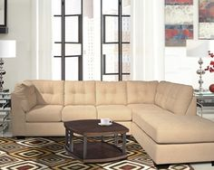 "Ashley Furniture, ""Maier Beige"" 2 piece Sectional; Destination: urban oasis. Elevate your design aesthetic with a chic look inspired by city high-rise living. Sleek, sultry and tailored to a T—with plush yet structured cushioning packed with metro modern flair"