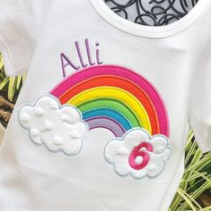 Somewhere over the Rainbow..... Girls Rainbow shirt with bright colors of the rainbow.....with 2 clouds of minky dot fabric on each end. Age has been