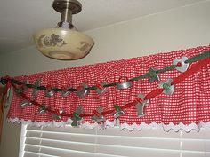 using old cookie cutters to make a banner in your kitchen.