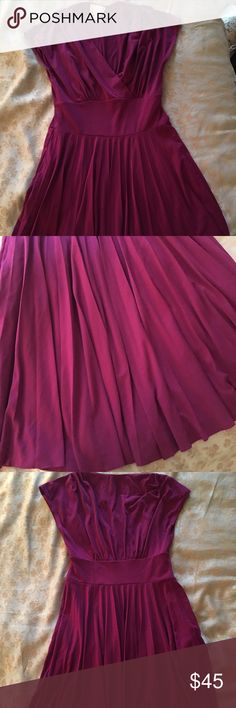 Donna Morgan dress Worn once!! Super great condition. Dress goes right above the knee. Dress is Burgundy in color Donna Morgan Dresses Midi