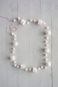 Here's how to make this Christmas your best yet. Thread marshmallows with red-and-white baker's twine for a sweet update.